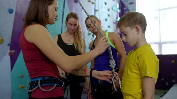 Thumbnail for Female Climbing Instructor Demonstrating Safety Gear for Beginners