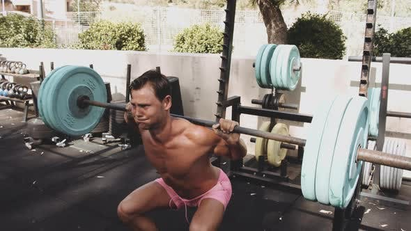 Thumbnail for Outdoor Gym and Shot of Man's Back Doing the Tire Flip Exercise
