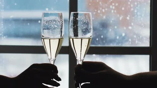 Clink glasses with champagne