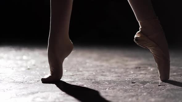 Thumbnail for Female Foot Standing in Spotlight on Black Background in Studio