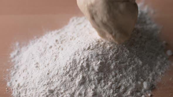 Thumbnail for Bread dough falling onto flour in super slow motion, shot on Phantom Flex 4K
