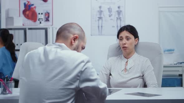 Thumbnail for Woman Crying at Doctor After Bad News