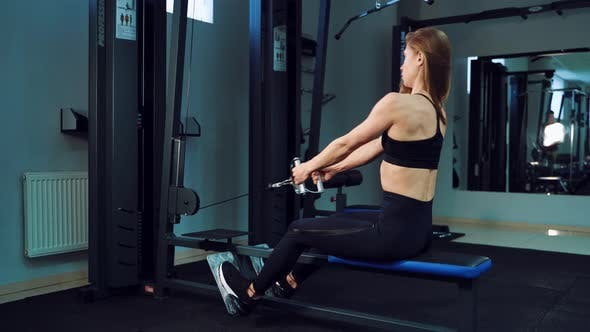 Thumbnail for Pretty Woman Performs Exercise to Strengthen Her Upper Back and Legs