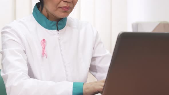 Thumbnail for Pink Ribbon Cancer Awareness Female Doctor Working at the Clinic