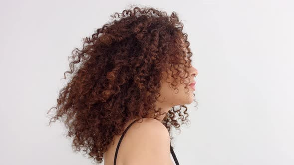 Thumbnail for Mixed Race Black Woman with Freckles and Curly Hair in Studio in Profile To a Camera