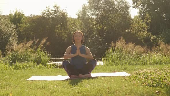 Practicing yoga outdoors