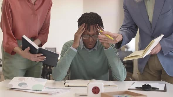 Sad African Man Having Difficulties at Work
