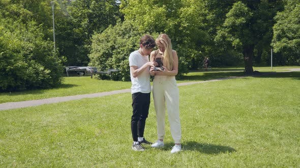 Couple Learning To Fly Drone