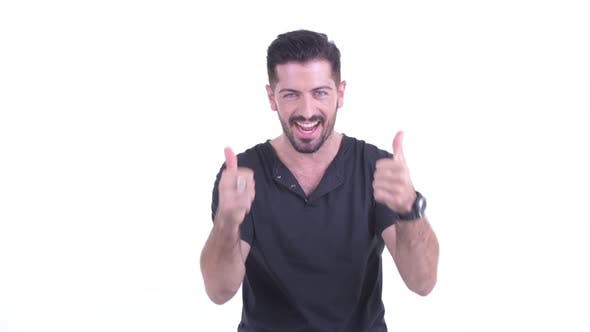 Thumbnail for Happy Young Handsome Bearded Man Giving Thumbs Up and Looking Excited