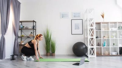 Sport at Home Internet Workout Woman Stretching