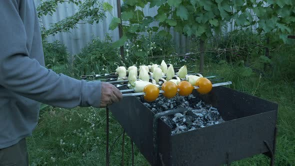 Thumbnail for Man preparing grilled vegetables on charcoal. Cooking vegetables on barbecue. Grilled tomatoes