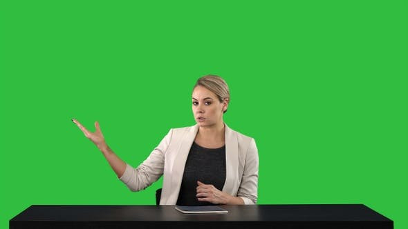 Thumbnail for Television anchorwoman at studio pointing to sides on a