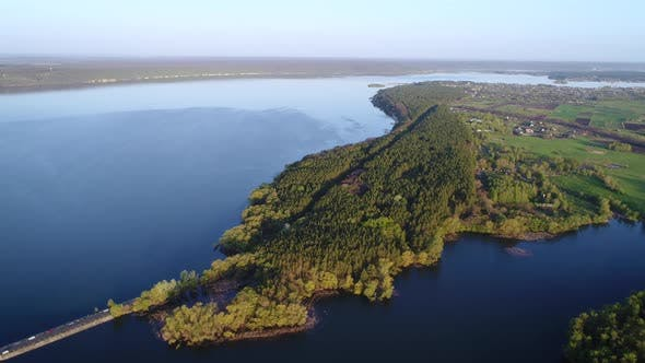 Thumbnail for Flying Over the River Dam. Aerial Camera Shot. Ukraine