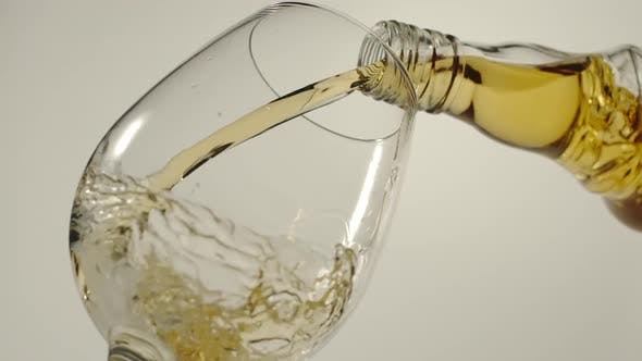 Thumbnail for Pouring whiskey from a bottle in a glass