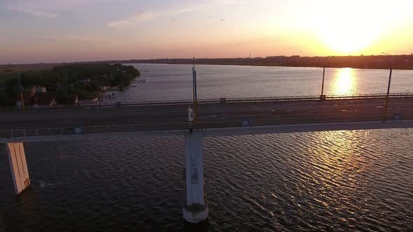 Cover Image for Aerial Shot of a Big Bridge at Pink Sunset From a Drone Moving Along in Summer