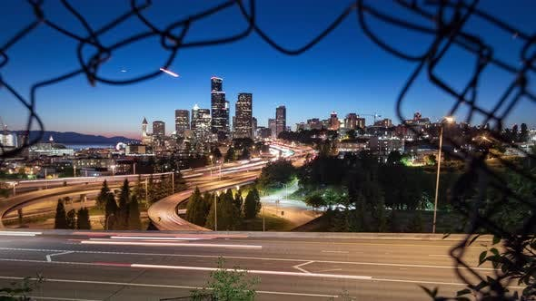 Thumbnail for Surreal Long Exposure Motion Time Lapse Of Seattle Washington Downtown City Skyline In Chain Fence