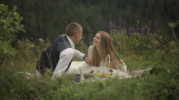 Thumbnail for Groom with Bride Having a Picnic on a Mountain Hills. Wedding Couple. Family