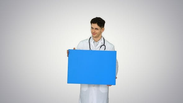 Thumbnail for Smiling Male Doctor Wearing a Stethoscope Holding Blank