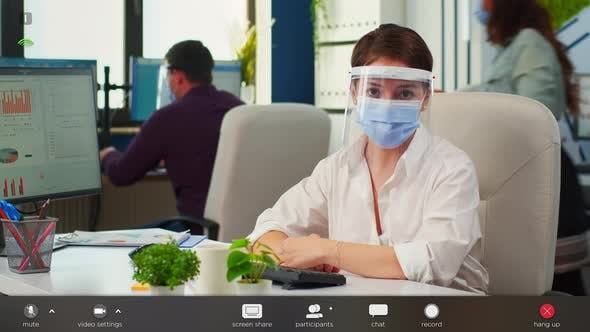 Thumbnail for Businesswoman with Visor and Mask Talking in Front of Camera