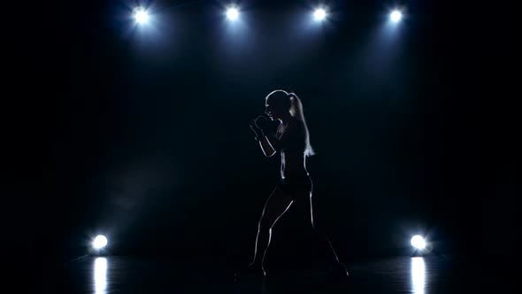 Thumbnail for Silhouette of Girl Boxer Who Trains Do Blows By Hands