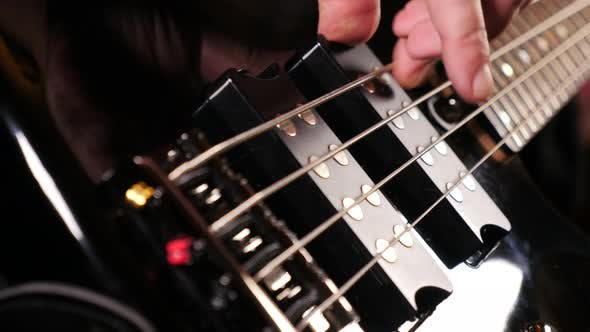 Playing A Bass Guitar