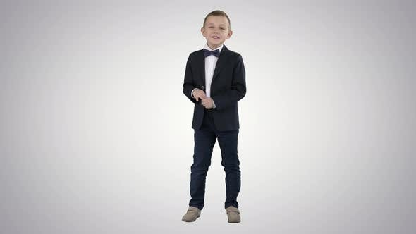 Thumbnail for Little Boy in Formal Outfit Talking and Smiling on Gradient Background.