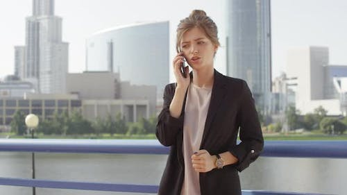 Emotional Business Woman Having Phone Call Outside