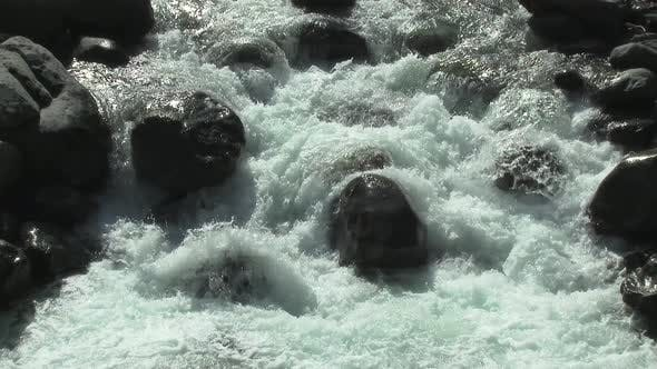 Thumbnail for Foamy Stream Flowing at the Bottom of the Valley