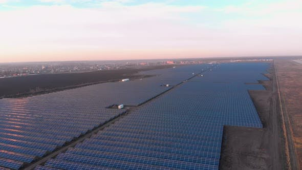 Thumbnail for Aerial Drone View Into Large Solar Panels at a Solar Farm. Solar Cell Power Plants, Footage Video