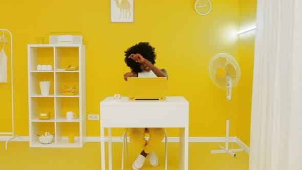 Successful Black Woman In Creative Yellow Office