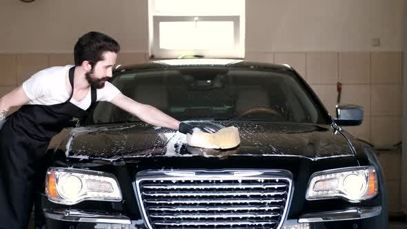 Thumbnail for Man Washing His Car in a Garage
