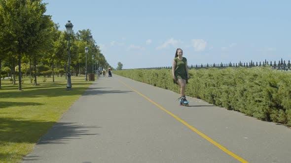 Thumbnail for Carefree Female Enjoying Freeride on Roller Blades