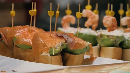 Showcase Window Display Assortiment with Tapas – Traditional Spanish Sandwiches Starters in a Cafe