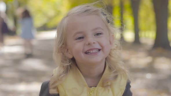 Thumbnail for Portrait of a Little Pretty Girl with Blond Hair and Brown Eyes Laughing