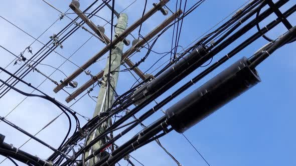 Thumbnail for Power Pole Covered in Utility Cables