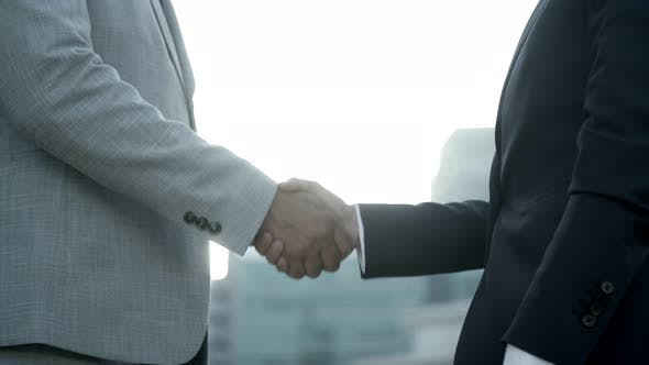Thumbnail for Side View of Business People Reaching Agreement