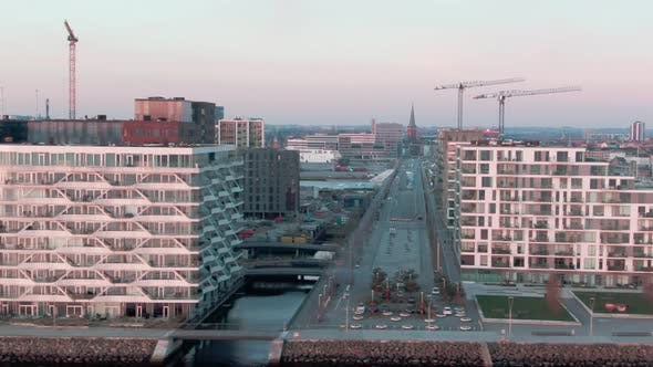 Drone Panning Shot of Buildings in Aarhus Revealing the Majestic Sea Waters at the End of the Clip