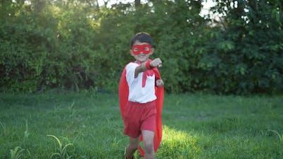 Hero boy in red running