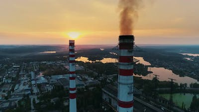 Aerial Drone Footage. Coal Fire Power Station at Sunset. Static Shot