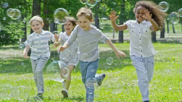 Cover Image for Laughing Boys and Girls Popping Bubbles in the Park