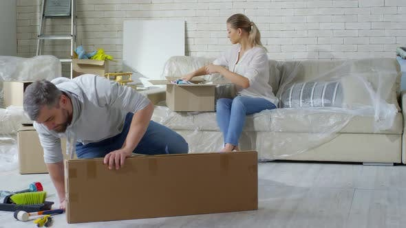 Thumbnail for Couple Packing Clothes before Moving