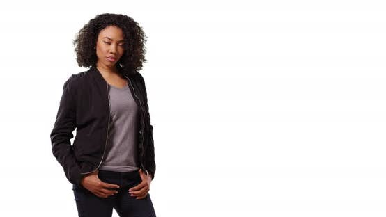 Thumbnail for Portrait of cute black female looking at camera with cool confidence in studio