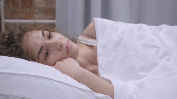 Cover Image for Female Dreaming while Lying in Bed