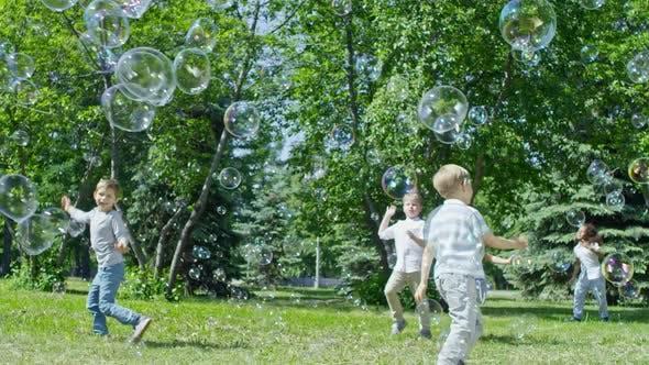 Thumbnail for Adorable Kids Bursting Huge Bubbles in Park