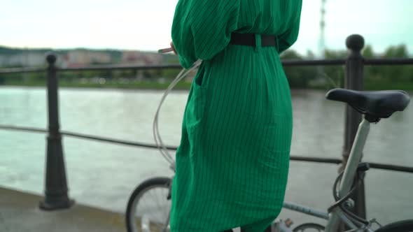 Thumbnail for Girl walking with a bike
