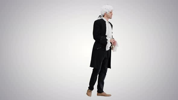 Man in 18Th Century Camisole and Wig Doing Welcoming Gesture on Gradient Background