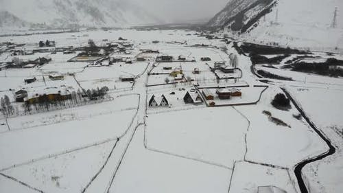 Drone Motion of Snowy Mountains Village.