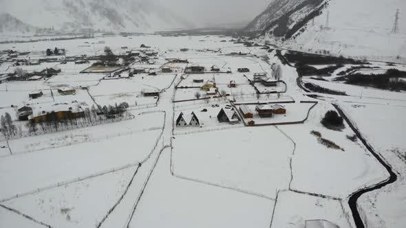 Thumbnail for Drone Motion of Snowy Mountains Village.