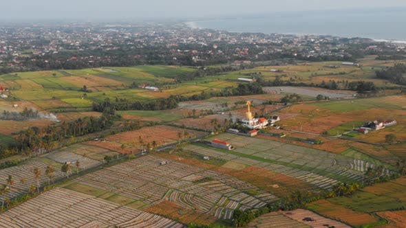 Aerial Flying Video of Balinese Temple Among Rice Fields, Tropical Island of Bali, Beautiful Temple