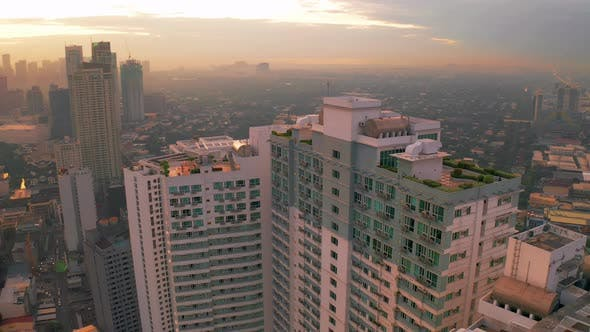 Thumbnail for Modern Building Sunrise Skyline Background in Manila City, Philippines. Aerial
